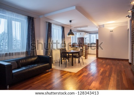 Country home - sofa and table in modern house - stock photo