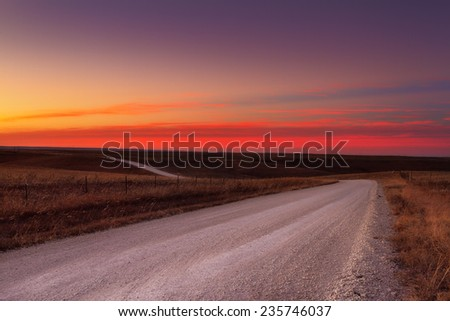 Country horizon skyline down a long deserted country road - stock photo