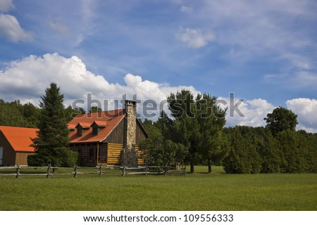 Country house with trees and land - stock photo