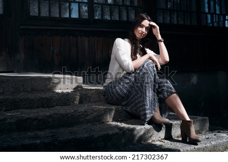 country lady in sun stripe near the house  in the afternoon - stock photo