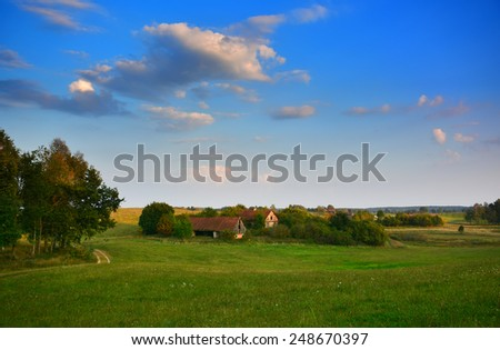 Country landscape with old farm in Poland, Europe - stock photo
