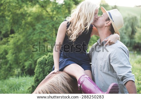 Country living, happy loving couple - stock photo