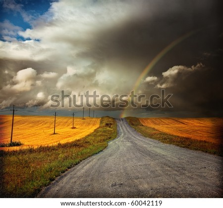 country road and rainbow  photo - stock photo