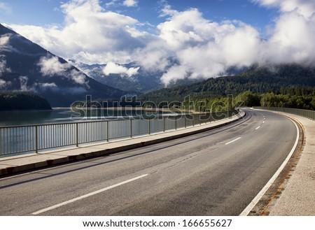 country road at the sylvenstein lake - bavaria - stock photo