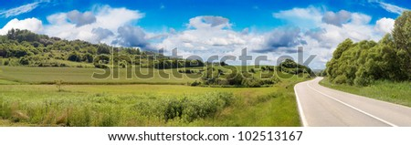Country Road in Spring Vanishing Panorama - stock photo