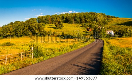 Country road in the rural Shenandoah Valley of Virginia. - stock photo