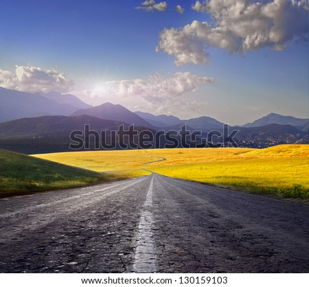 Country road in the valley. - stock photo