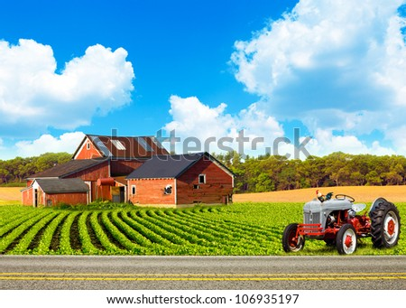 Country Road With Farm And Tractor - stock photo