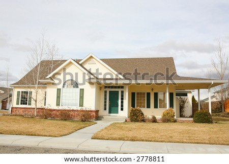 Country style yellow house - stock photo