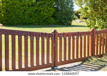 Country Wooden Gate Entry to Courtyard. Sunny day - stock photo