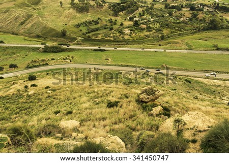 Countryside from above. Aerial view of meadows, cultivated fields and highways. Birds view. Arable land. - stock photo