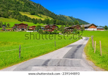 Countryside road to alpine village in summer, Austria - stock photo