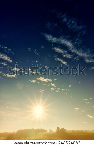 countryside with sky clouds and sunlight  - stock photo