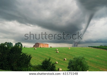 countryside with tornado near the barn - stock photo