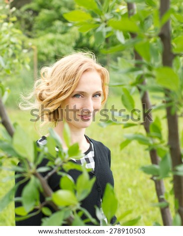 Countryside woman nature portrait - stock photo