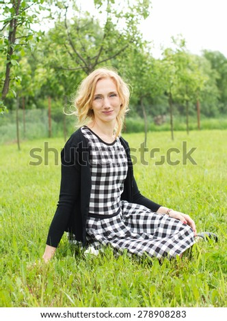 Countryside young woman - stock photo