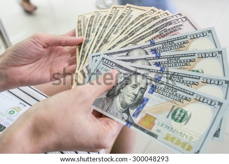 counts money in hands - stock photo