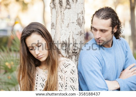 Couple are upset with each other outdoors - stock photo