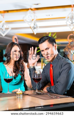 Couple arguing in restaurant - stock photo