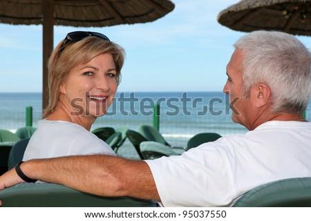 Couple at a beach cafe - stock photo