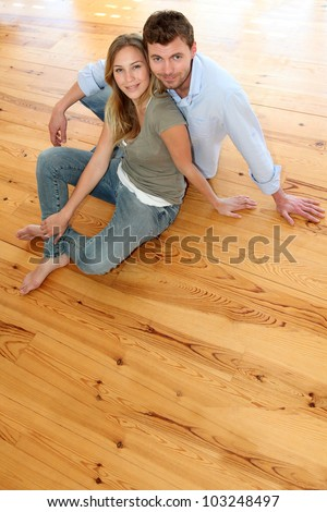 Couple at home relaxing on the floor - stock photo