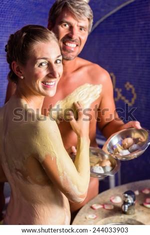 Couple at Rasul bath in wellness spa - stock photo