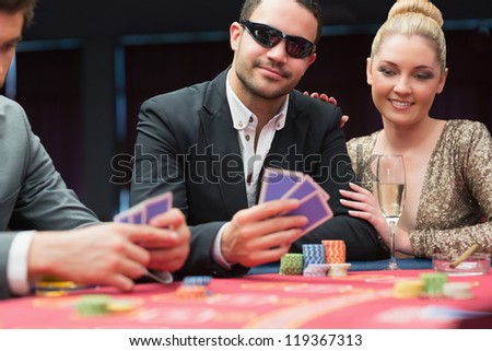 Couple at the poker table in casino - stock photo