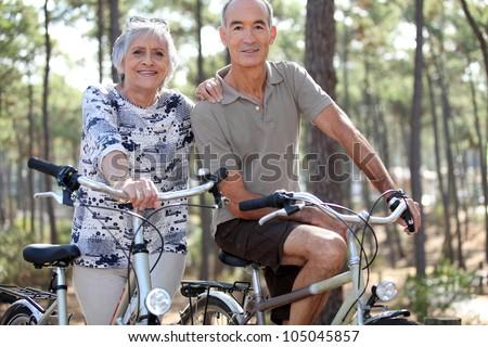 Couple biking - stock photo