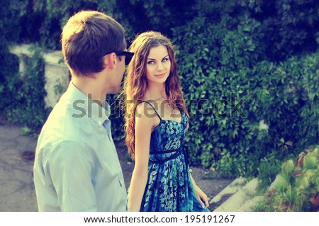 Couple. Boy and girl walk in the park  - stock photo