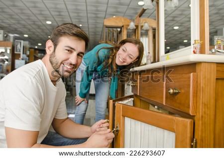Couple buying furniture at big plumbing store - stock photo
