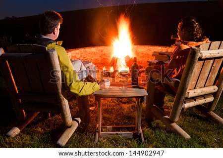 Couple by the bonfire - stock photo
