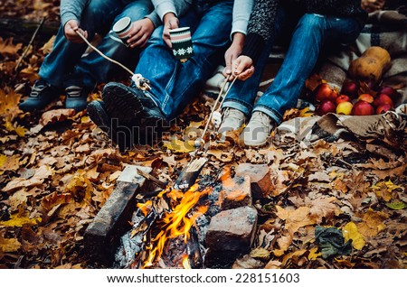 couple camping in the autumn forest. Fall background - stock photo