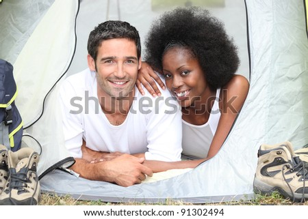 couple camping together - stock photo