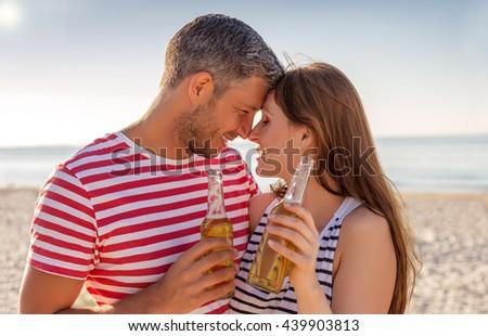 couple celebrating fiesta on the summer beach - stock photo