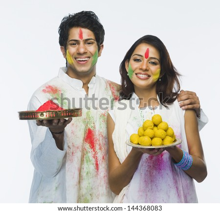 Couple celebrating Holi - stock photo