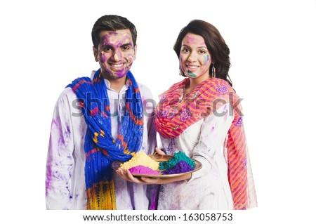 Couple celebrating Holi with Holi colors - stock photo