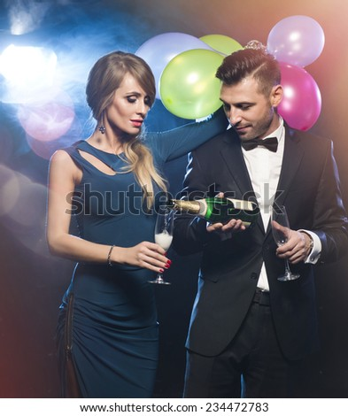 Couple celebrating new year's eve  wth champagne  - stock photo
