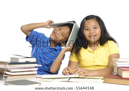 Couple children doing their homework together, - stock photo