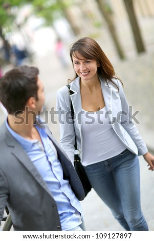 Couple climbing stairs in town - stock photo
