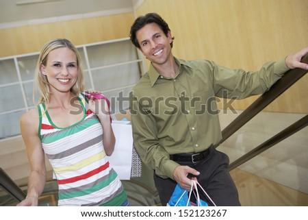Couple Climbing Stairway - stock photo