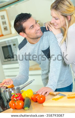 Couple cooking a meal - stock photo