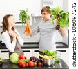 Couple cooking in modern kitchen - stock photo