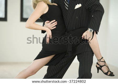 Couple dancing Argentine Tango in Pose 1.1 - stock photo