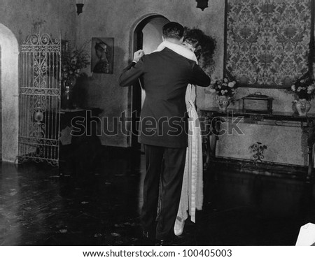 Couple dancing at home - stock photo