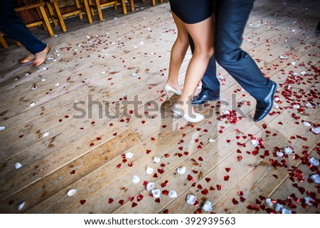 Couple dancing on a dance floor during a wedding celebration/party (motion blurred image) - stock photo
