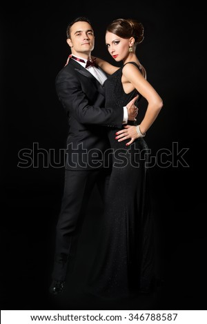 Couple dancing tango.Beautiful young couple in love dancing passionate dance. Studio shot.  - stock photo