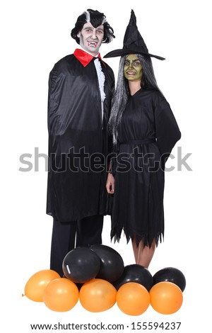Couple disguised in vampire and witch - stock photo