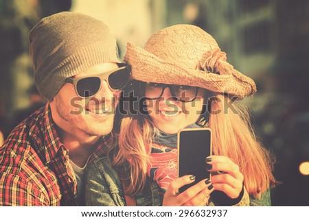 Couple doing selfie outdoors. - stock photo