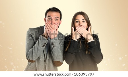 Couple doing surprise gesture over ocher background  - stock photo