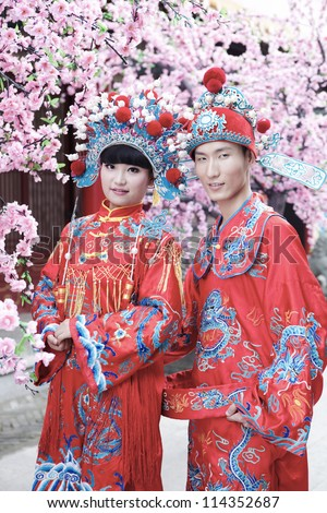 Couple dressed in traditional Chinese wedding - stock photo